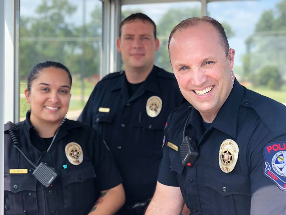 Officer Wood on the left,  Officer Kendrick on the Right, and Officer Toney behind them in the middle