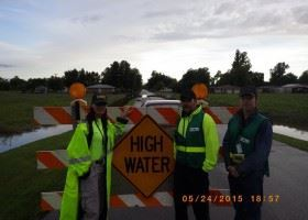 High Water Sign with Crew